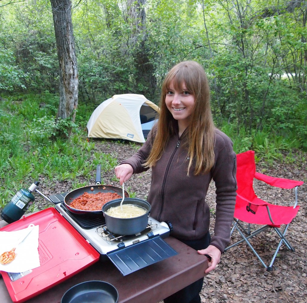 Kristen cooking spaghetti on a camp stove