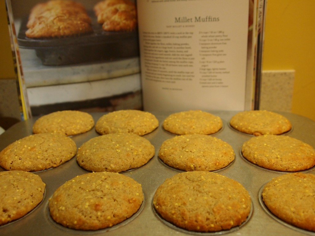 muffins in pan with cookbook