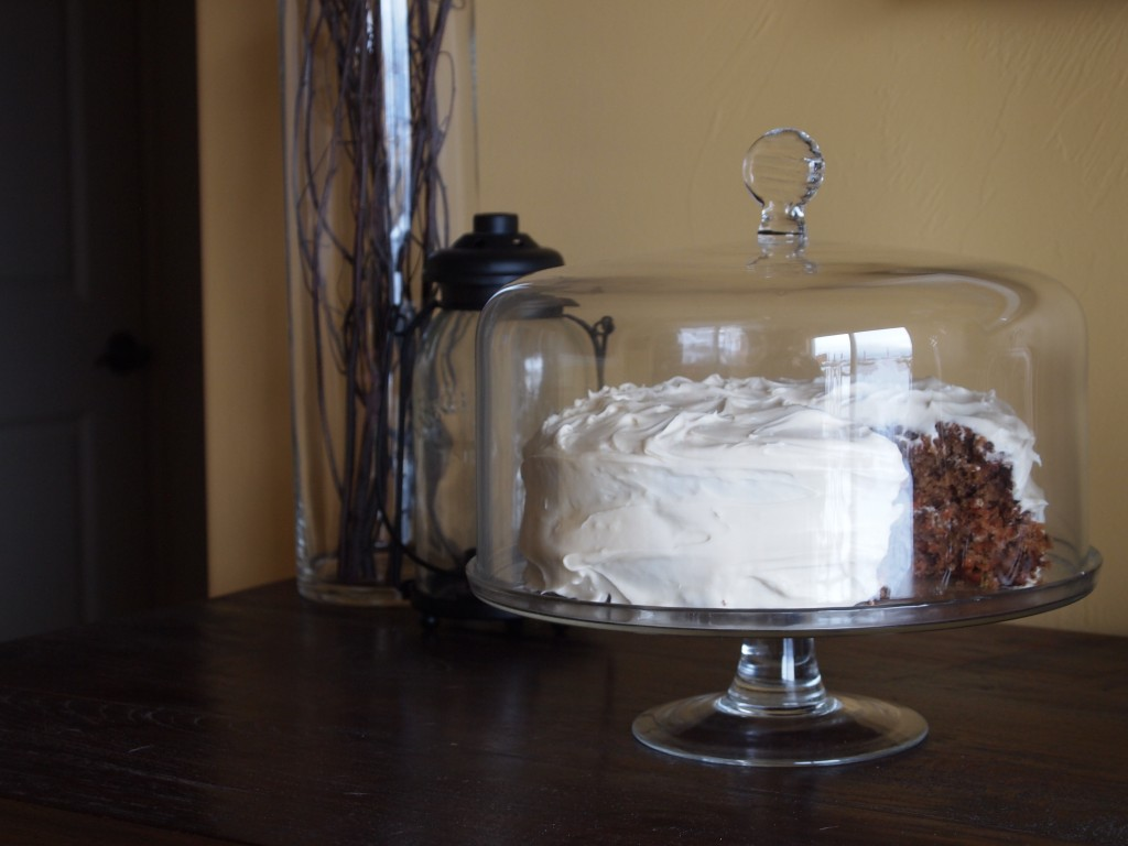 carrot layer cake on a pretty cake stand